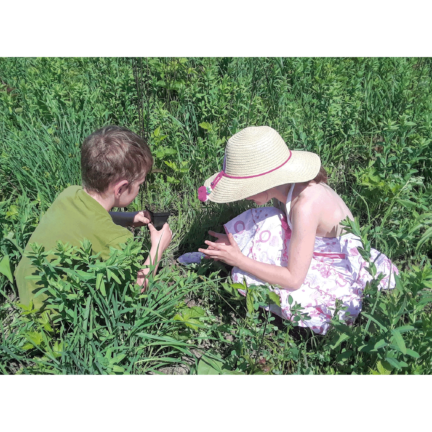 Photo of two children planting natives